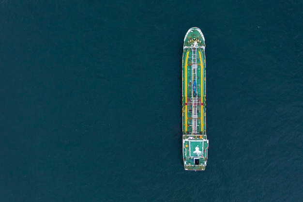 Aerial view of gas storage tank on ship in port, refinery industry and export cargo ship