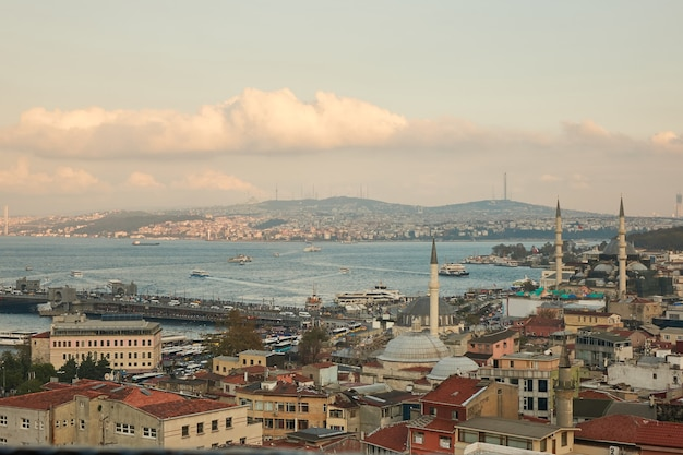 Aerial view of the golden horn and the bridge of the galata of the roofs of houses and the tower of the mosque. istanbul, turkey