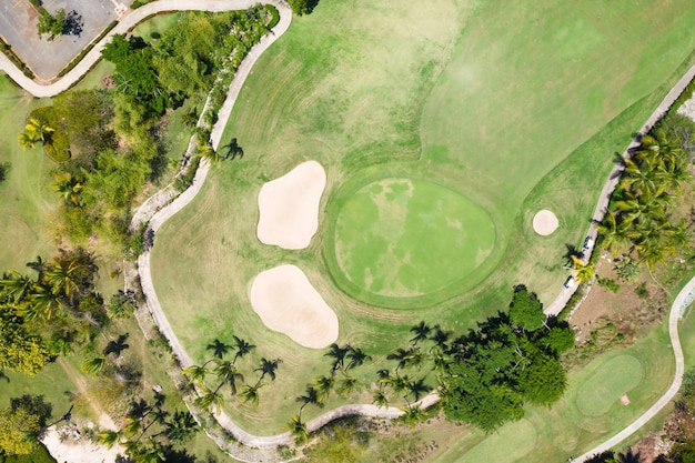 Aerial view on golf course with road and palm trees