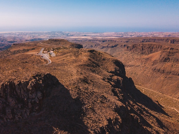 Aerial view of the gran canaria desert road through the mountains