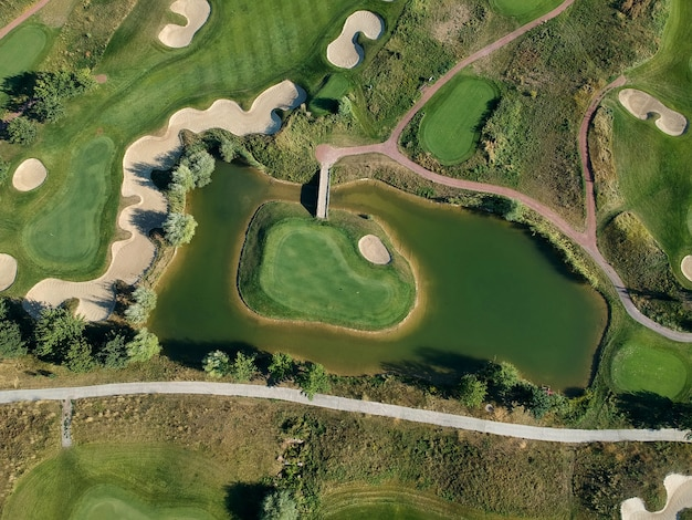 Aerial view of the green grass of the golf course. top view.