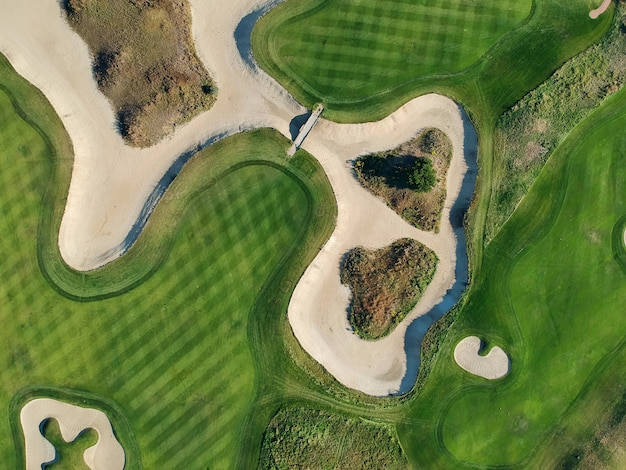 Aerial view of the green grass of the golf course.