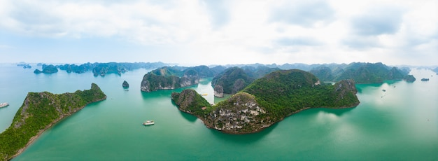 Aerial view of ha long bay cat ba island, unique limestone rock islands and karst formation peaks in the sea, famous destination in vietnam