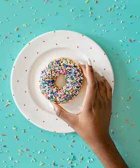 Aerial view of hand getting donut