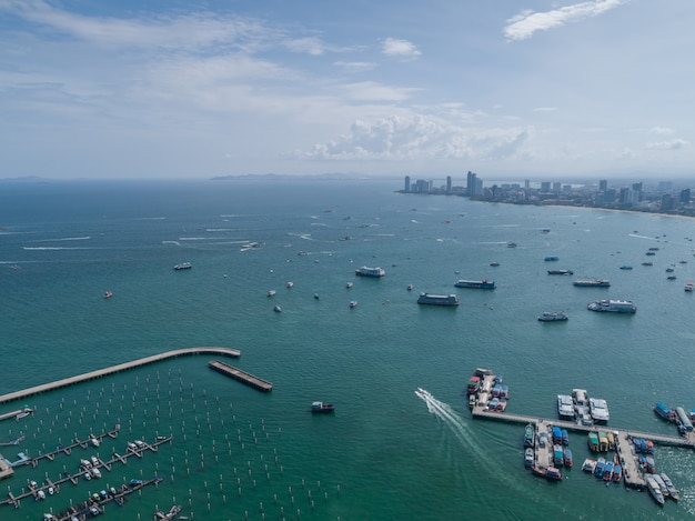 Aerial view on harbor with luxury yachts - sailboat harbor, many beautiful moored sail yachts in the sea port with blue sky clouds.