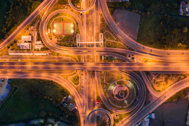 Aerial view of highway junctions top view of urban city, bangkok at night, thailand.