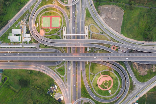 Aerial view of highway junctions. top view of urban city, bangkok at night, thailand.