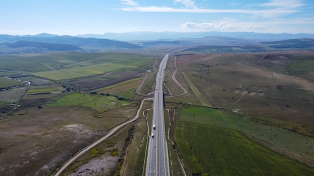 Aerial view of highway on summer day.