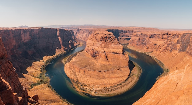 Aerial view of the horseshoe bend is a famous meander on the river with a blue sky