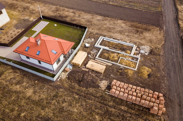 Aerial view of a house and building site.