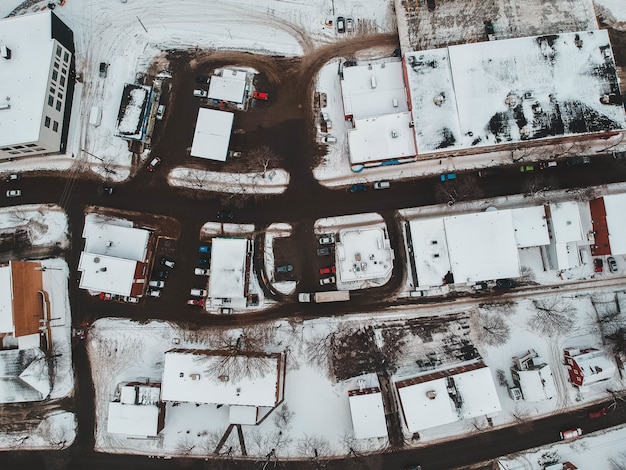 Aerial view of houses covered with snow