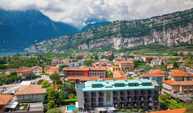 Aerial view of the houses in small village torbole with the mountains, lake garda, italy