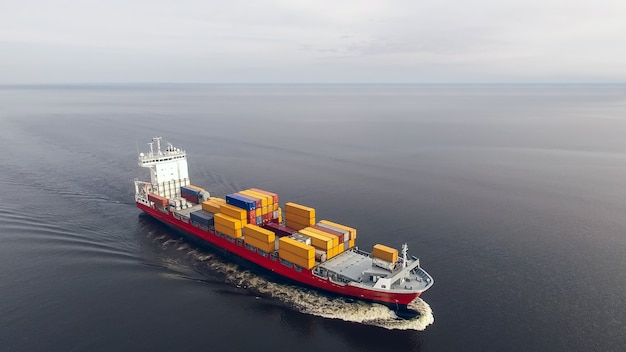 Aerial view of huge container ship floating in the sea