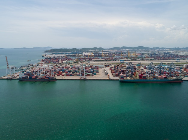 Aerial view of industrial port with containers, large container vessel unloaded in port