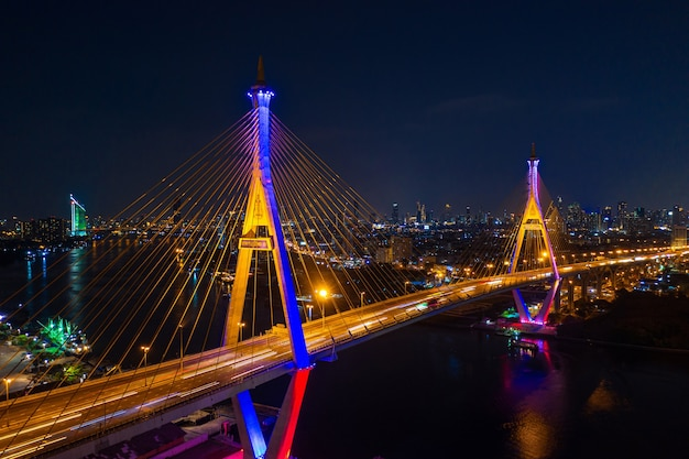 Aerial view of industry ring suspending bridge at night in bangkok, thailand.