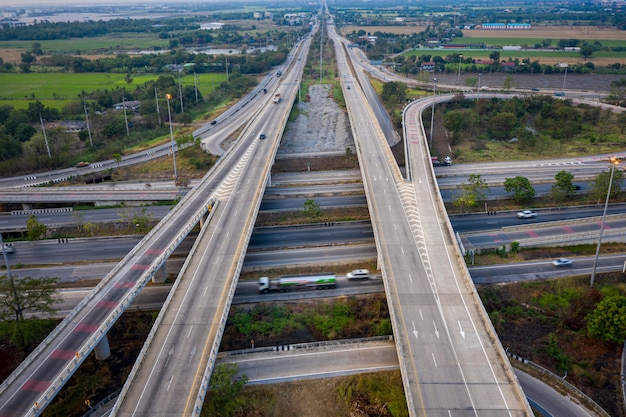 Aerial view interchange freeway overpasses and motorway ring road connecting in the city transportation logistics concept in thailand