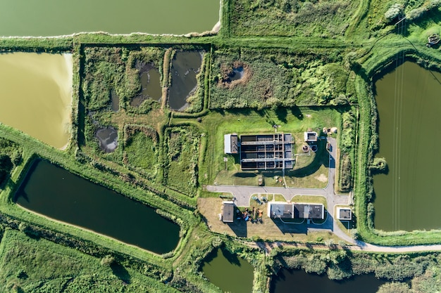 Aerial view of ity station for wastewater treatment. a lot of ponds with dirty and cleaned water.
