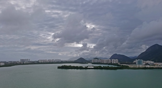 Aerial view of jacarepagua lagoon in rio de janeiro. cloudy day. mountains and buildings in the background. drone photo.