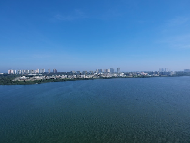 Aerial view of jacarepagua lagoon in rio de janeiro. sunny day. mountains and buildings in the background. drone photo.
