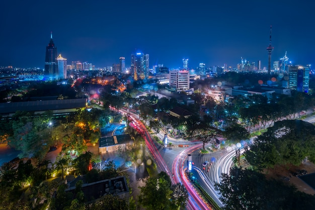 Aerial view of jakarta central business district at dusk (blue hour). jakarta cityscape at sunset. jakarta cityscape. widescreen photo.  java island, indonesia.