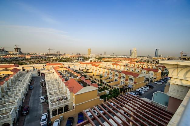 Aerial view of jumeirah village circle, a radial community in dubai