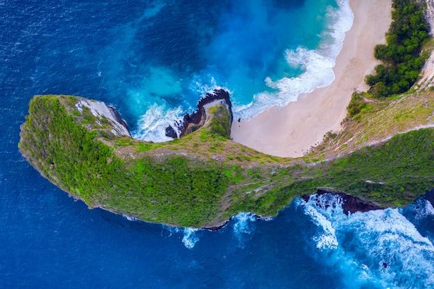 Aerial view of kelingking beach in nusa penida island, bali in indonesia.