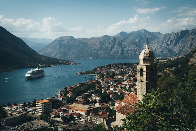 Aerial view of kotor bay. cruise ship docked in beautiful summer day.