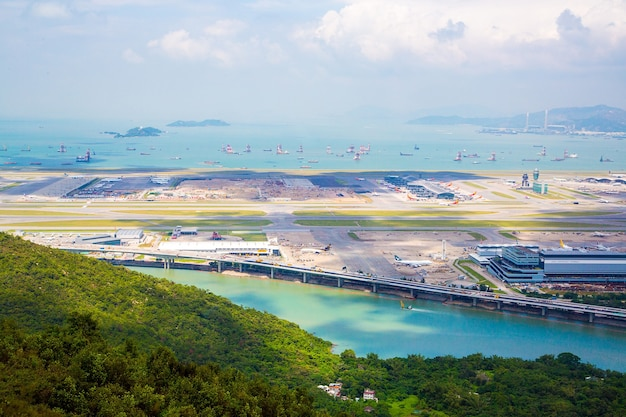 Aerial view of the lantau island bridge and the ocean in hong kong on a summery vibe