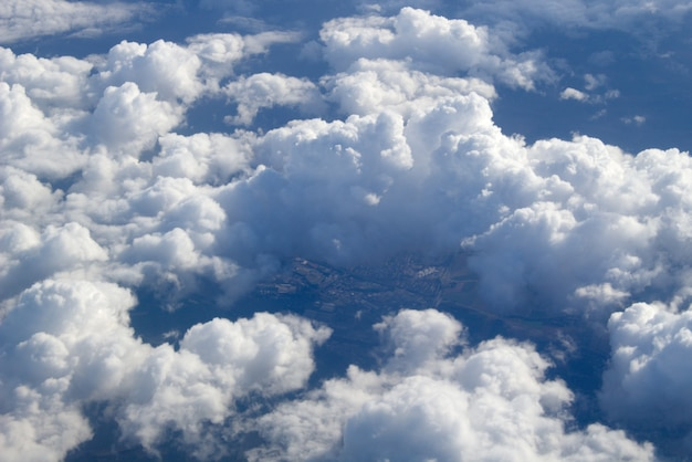 An aerial view of large cumulus clouds in the air