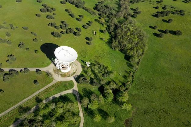 Aerial view of large telecommunications antenna or radio telescope satellite dish