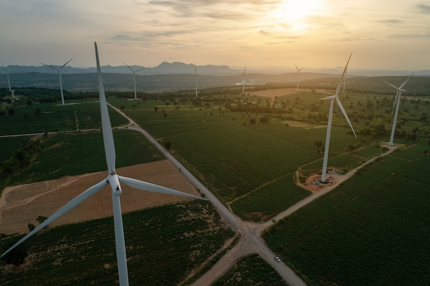 Aerial view of large wind turbines at sunrise taken from the air. wind turbines farm park.