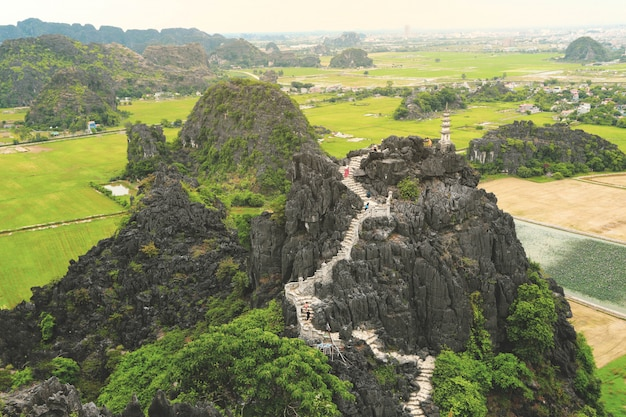 Aerial view over limestone mountains of tam coc national park in ninh binh province, vietnam