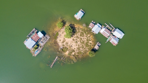Aerial view of little island with boats