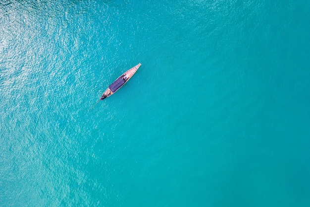 Aerial view of long tail boat on ocean, thailand.