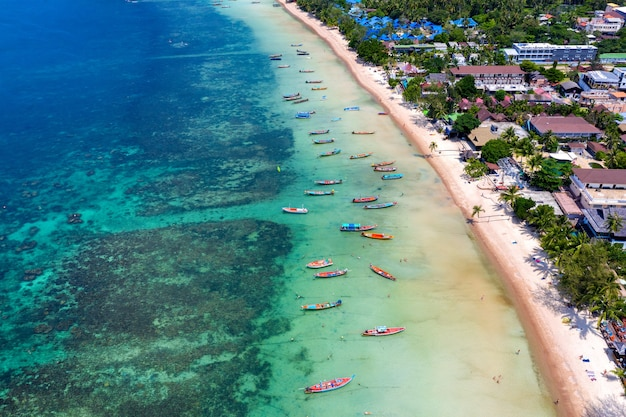Aerial view of long tail boats on the sea at koh tao island, thailand