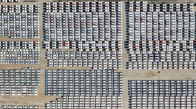 Aerial view lot of vehicles on parking for new car for export, business and logistics