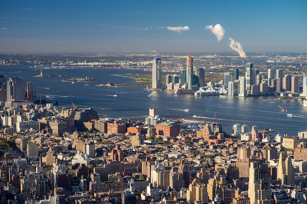 Aerial view of the lower east side of manhattan with brooklyn in the background.