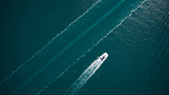Aerial view of luxury floating boat on blue adriatic sea.