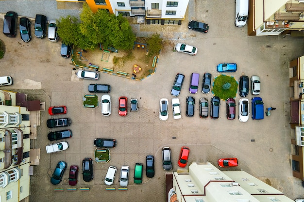 Aerial view of many colorful cars parked on public parking lot
