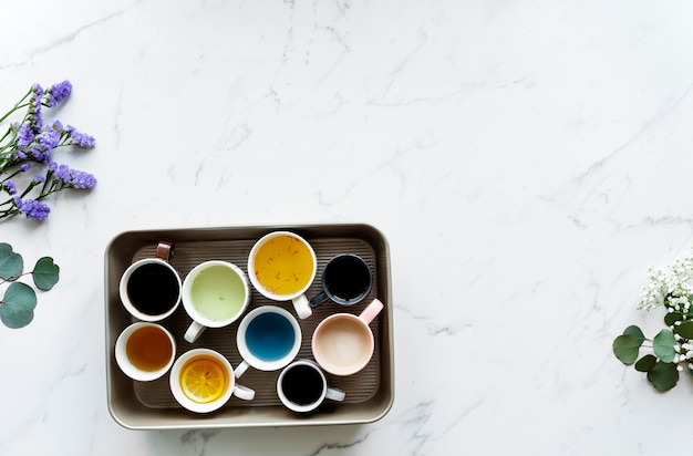 Aerial view of many different cups of beverages