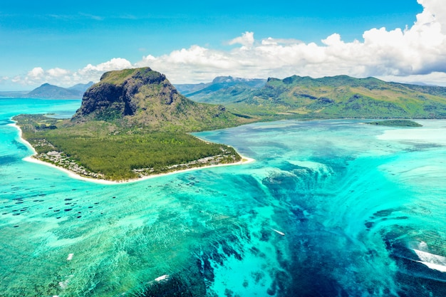 Aerial view of mauritius island - le morne brabant mountain with underwater waterfall and optic illusion