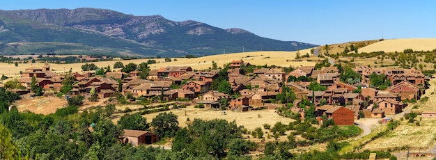 Aerial view medieval village in the mountains called madriguera in segovia spain.