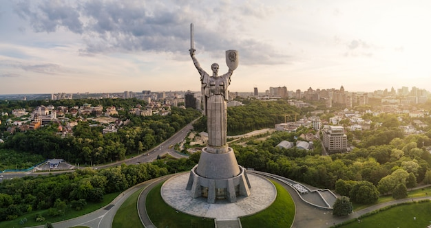 Aerial view of motherland monument at sunset.