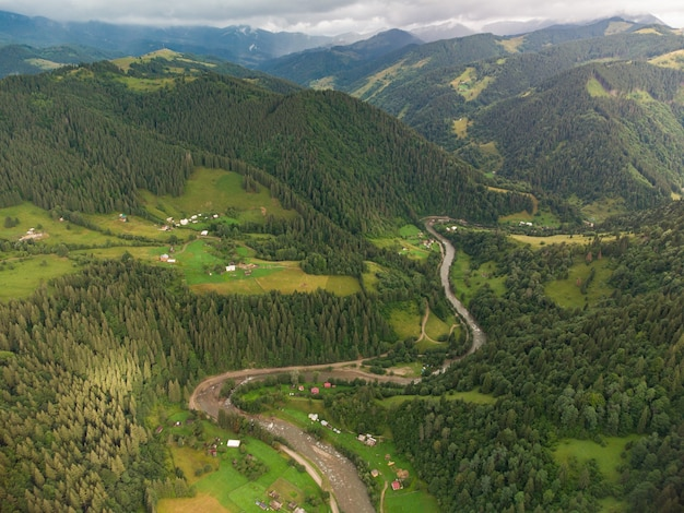 Aerial view of mountain village in carpathians in summer day