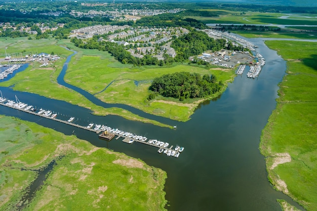 Aerial view naval maritime sailing port small with motor boats lined up along the pier ocean