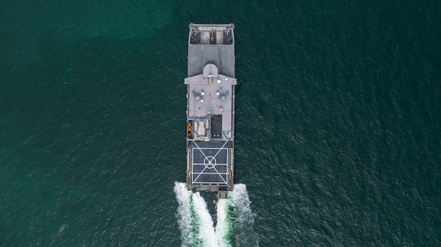 Aerial view navy military ship in the open sea, aerial view amphibious ship transport.