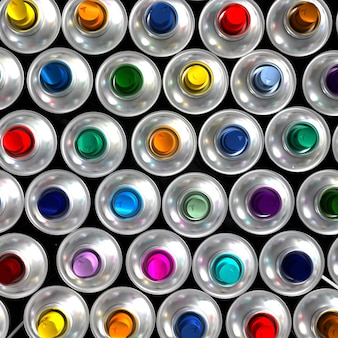 Aerial view of neatly arranged aerosol cans with different colored nozzles