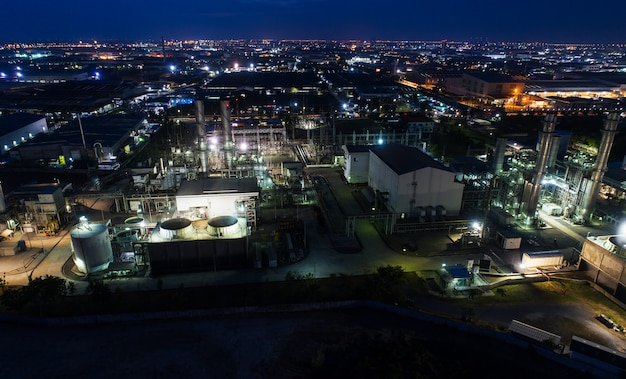 Aerial view night light oil terminal is industrial facility for storage of oil and petrochemical.
