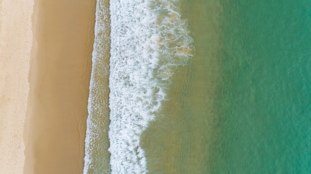Aerial view of the ocean waves washing on the coast of the andaman ocean amazing top down nature landscape seascape view beautiful for travel background and website.
