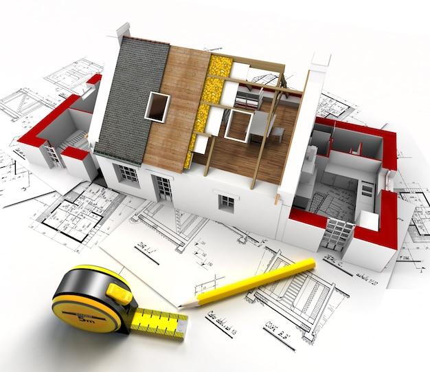 청사진 및 건축가 작업 도구와 함께 건설중인 집의 공중보기